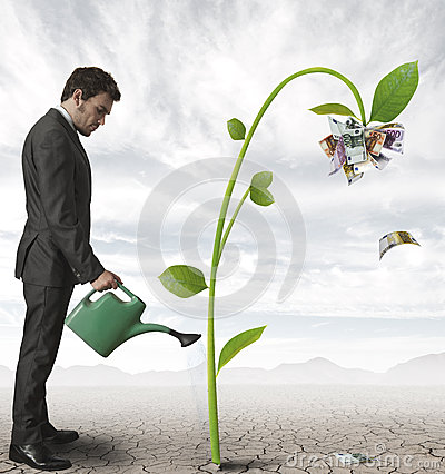 businessman-plant-money-26102136
